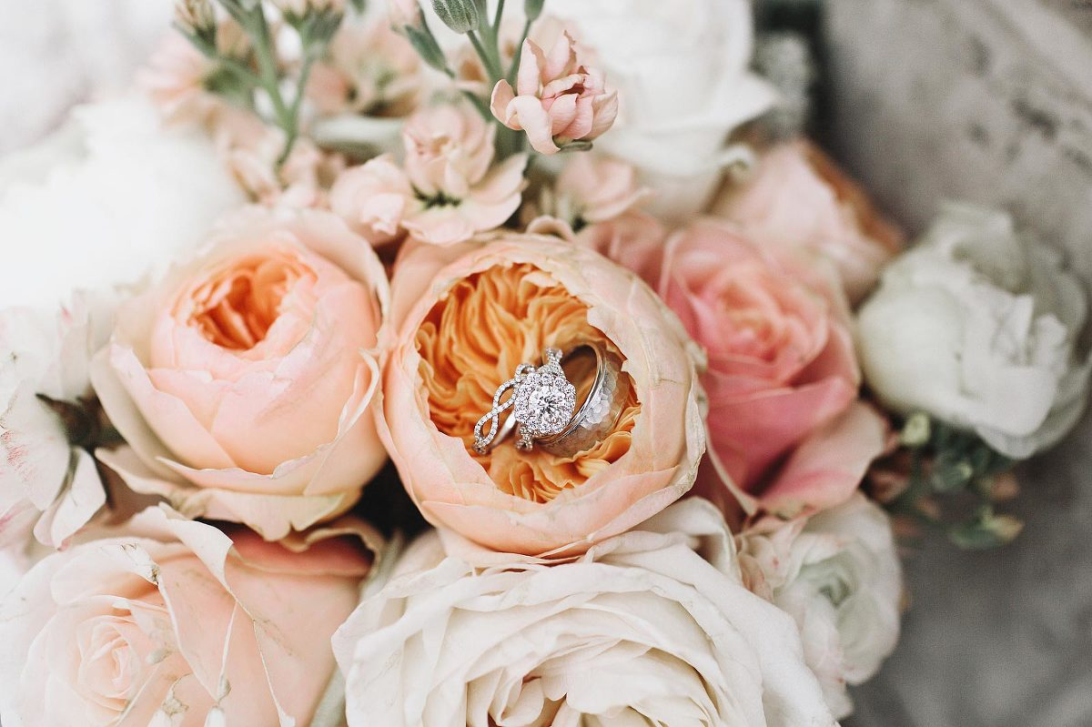 Wedding floral bouquet with diamond bridal ring set featured by Victoria BC wedding planner Party Mood