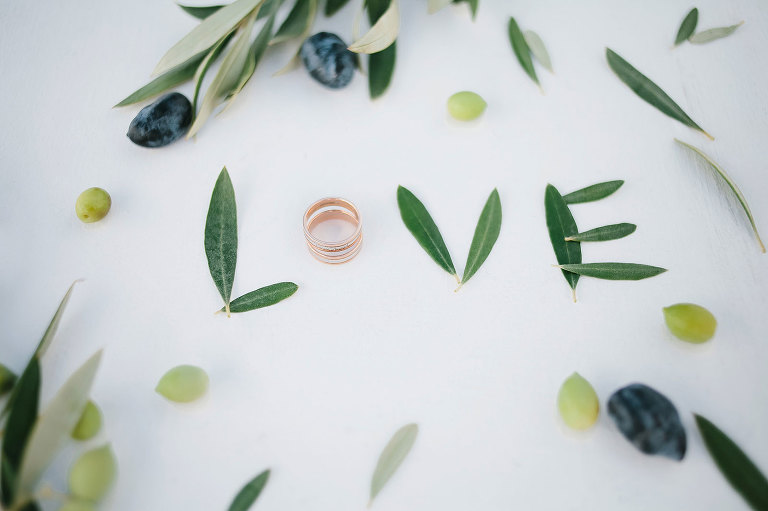 """Wedding bands with the word """"LOVE"""" spelled in olive leaves featured wedding styling by Vancouver BC wedding planner Party Mood."""