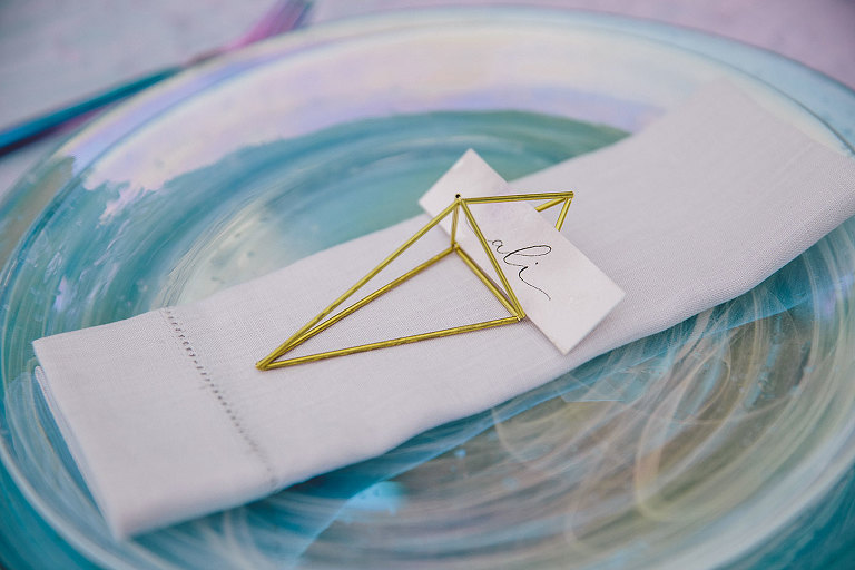 Geometric place card holders with hand calligraphy are ideally suited to the new age style of this modern wedding design on the beach in Victoria BC designed by Party Mood.