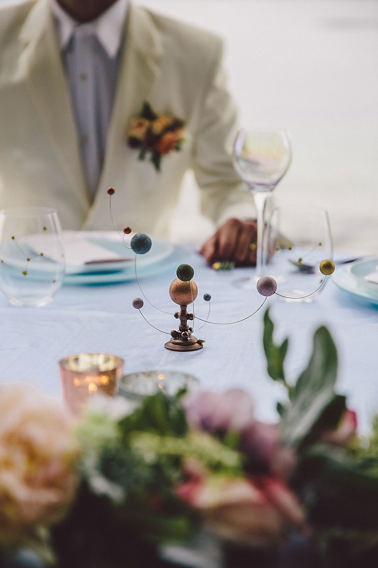 An orrery planet centerpiece is a focal point to the sweetheart table for a modern lunar themed Victoria wedding design by Party Mood.
