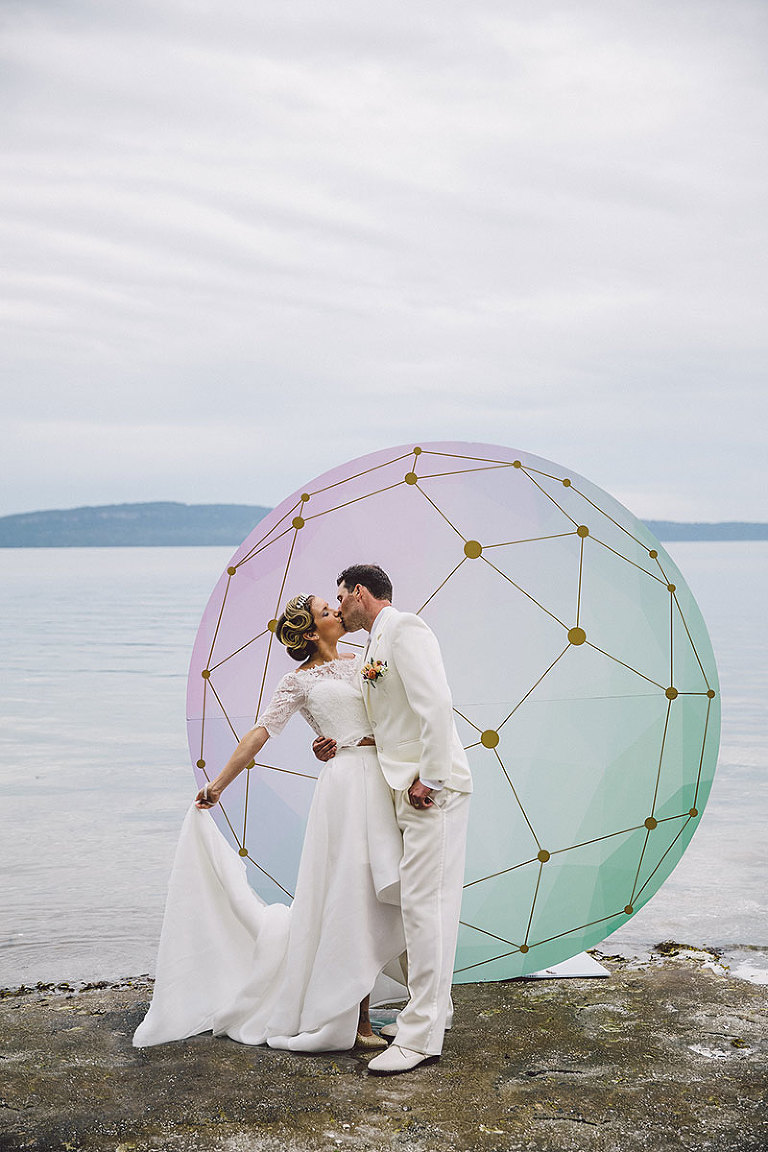 Bride and groom in front of a celestial orb for a beach wedding in Victoria BC designed by Party Mood.
