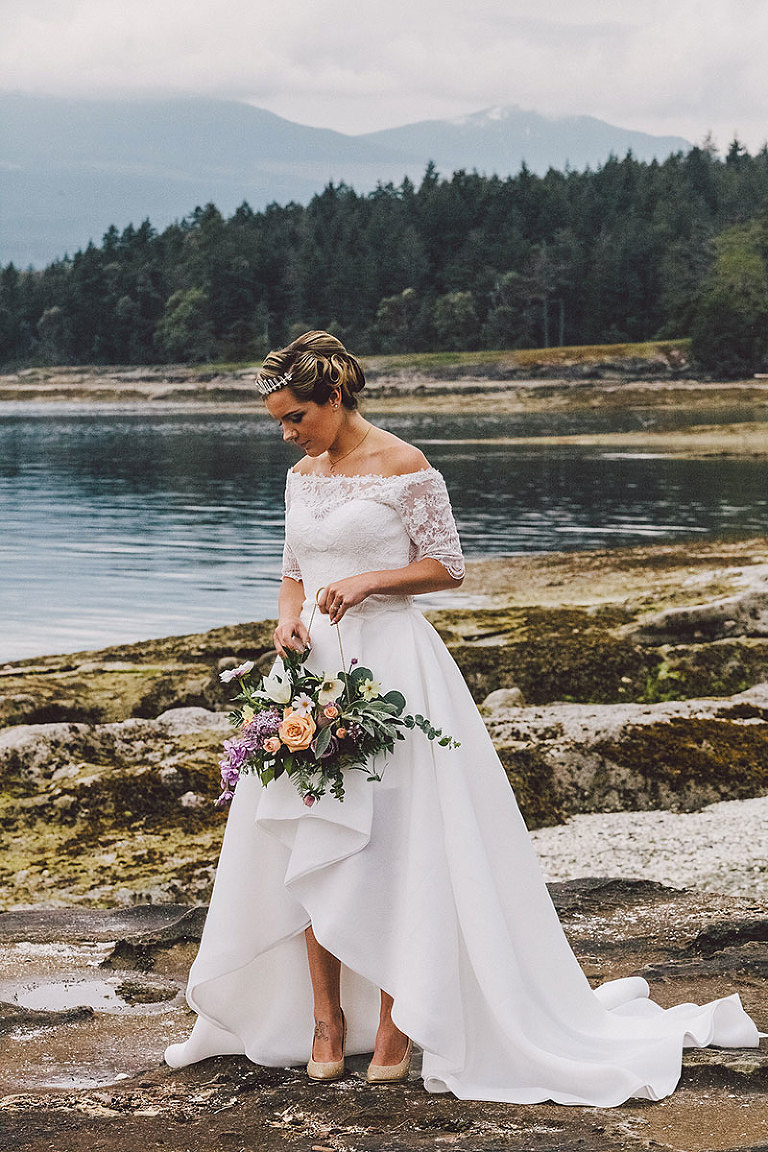 A contemporary styled wedding gown with lace bodice for a seaside modern wedding styling by Party Mood.