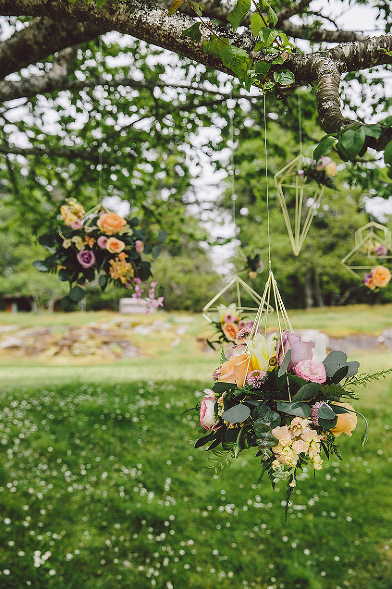 Hanging geometric fixtures for modern wedding floral designs for an outdoor beach wedding in Victoria BC styled by Party Mood.