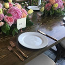 Rose gold cutlery place setting show with a pastel wedding decor palette styled with wedding decor rental items from Party Mood