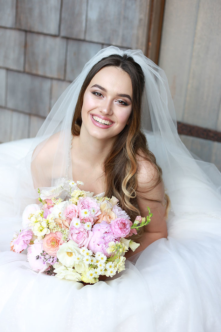 Bride holding a pastel bridal bouquet for a pastel themed wedding styled by local Victoria BC wedding planner Party Mood.