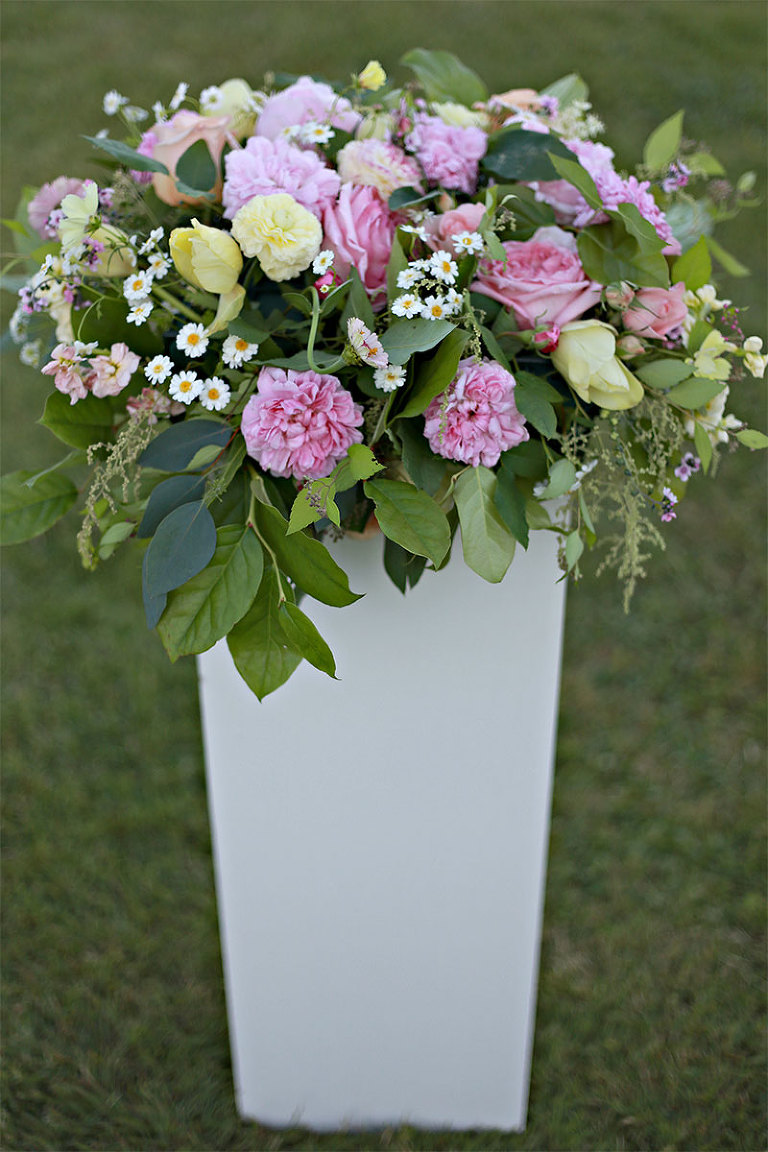Pastel floral arrangement in white pedestal planter from Victoria BC wedding rental company Party Mood.