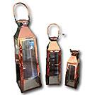 Set of three copper lanterns from wedding decor rental company Party Mood.