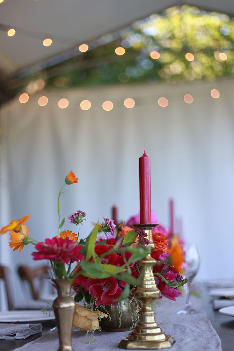 A bold and bright wedding color palette offset by the luster of brass.