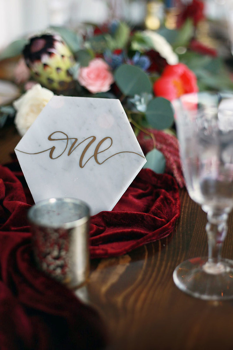 An elegant marble table number marker from the Party Mood wedding decor rental inventory.