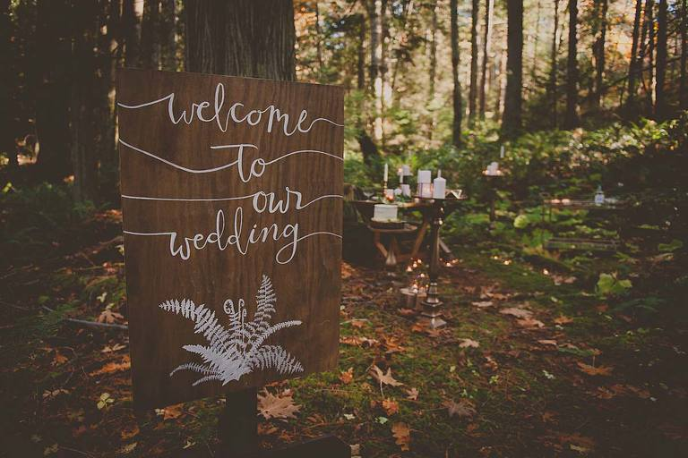 """A rustic """"Welcome To Our Wedding"""" sign for a woodland inspired themed wedding makes the perfect entry point for the style shoot filled with rustic woodland wedding decor ideas."""